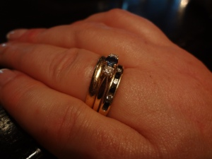 That middle ring is my 20th anniversary gift to my wife.  It looks bigger than it is.  She lost her engagement ring several years ago, and this is kind of a replacement.