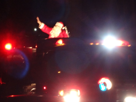 Every year our neighborhood lights a giant tree, and Santa pulls the switch.  Then the fire dept. rides him around on a truck.
