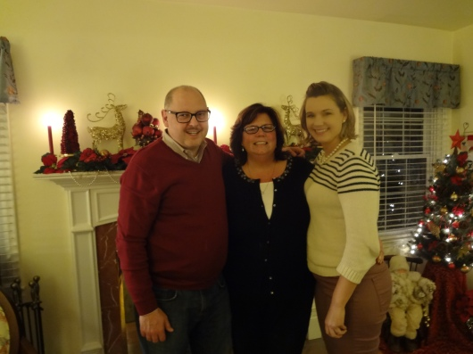 The Great Spousal Unit, The Live-In Niece, and myself at our holiday open house.