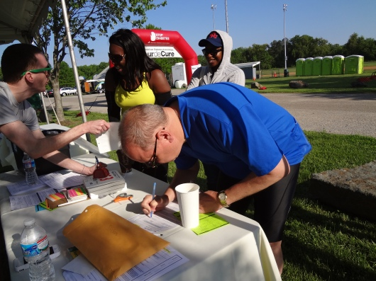 At the registration table, before I got my Red Rider jersey.  The woman in yellow behind me came all the way from Seattle for this ride.