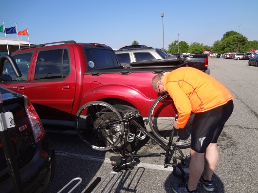 Putting the front wheel on my bike before the ride.  This is notable only if you want to see what my truck looks like, or you really wanted to see a 52 year old in bike shorts.