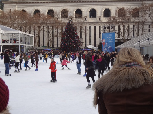 Ice skating in Bryant Park.  That's the New York Public Library in the background.  Surrounding all this are scores of gift kiosks and places to grab a quick bite to eat.  No wonder it's such a gathering place.