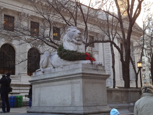 One of the famous lion statues in front of the library, dressed in a wreath.