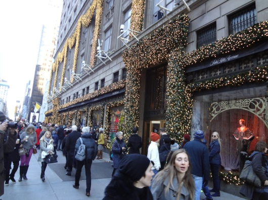 The outside of Saks Fifth Avenue.  In the background (look for the yellow & white flag) you can just make out the front of St. Patrick's cathedral, which is in the middle of extensive renovations.